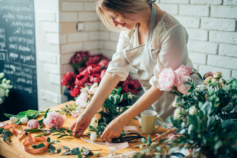 florist arranging plants in flower shop