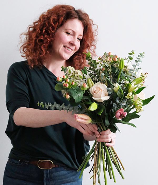 Woman making bouquet