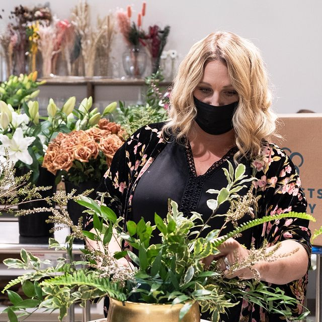 Julie Myers of the Floral Fixx designing a fall arrangement